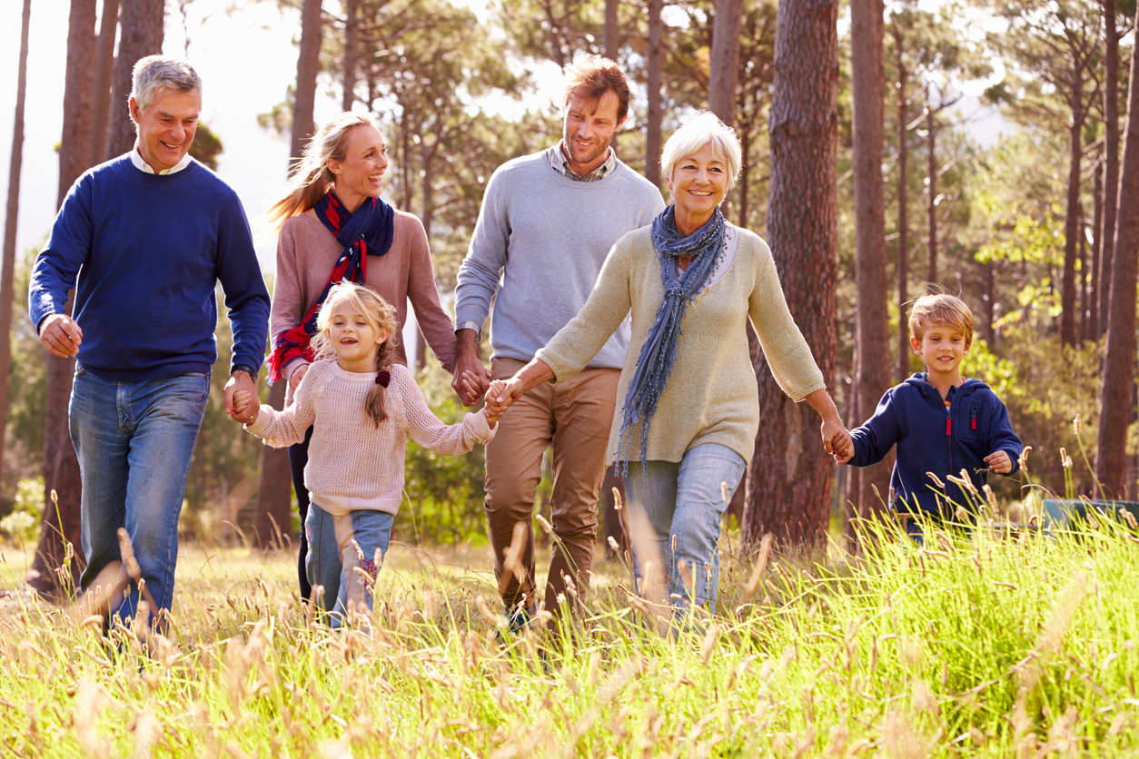 family running through a field living pain free